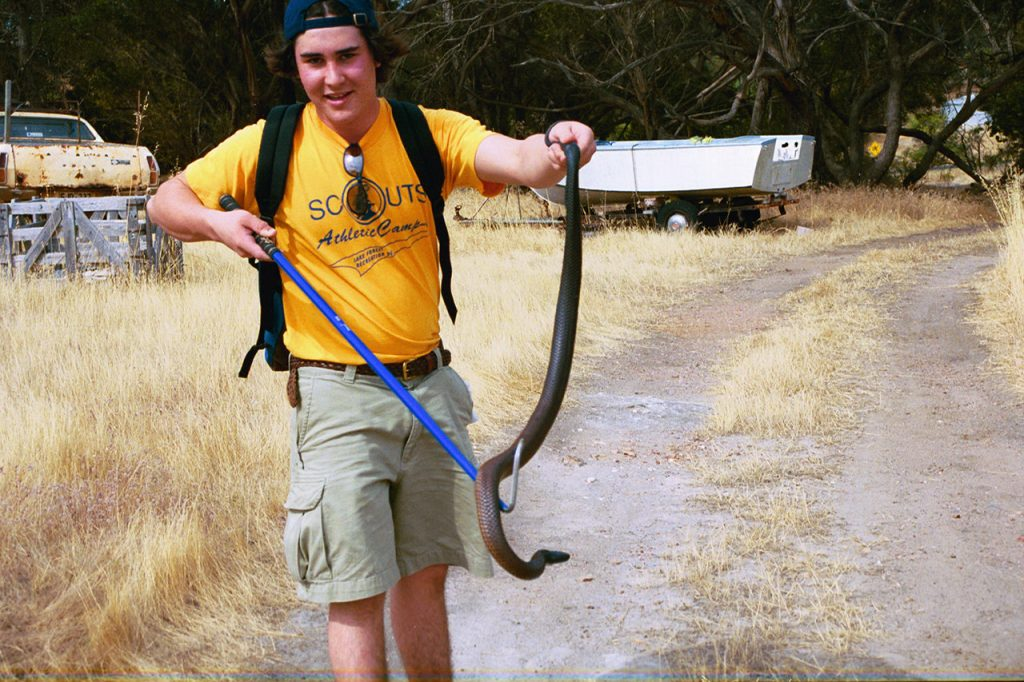 Younger Max holding a snake