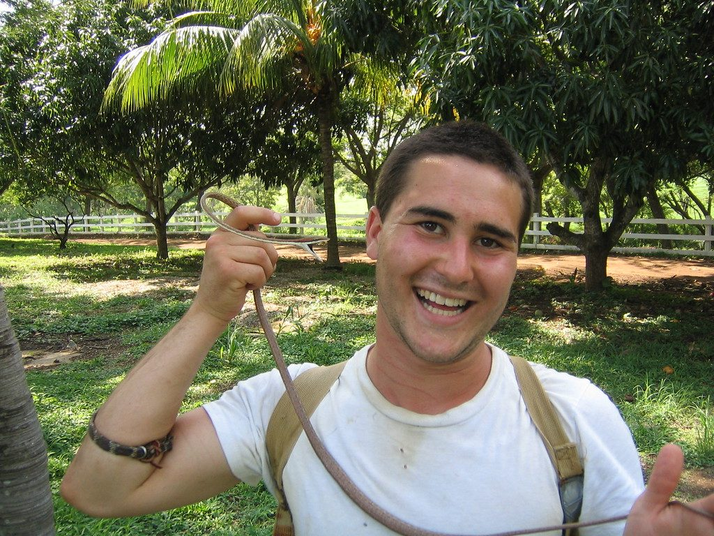 Max smiling holding small snake