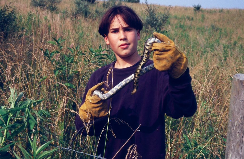 Max from childhood holding snake